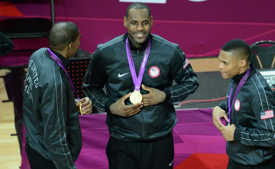 US forward LeBron James (C) poses with his gold medal after winning the London 2012 Olympic Games men's basketball competition at the North Greenwich Arena in London on August 12, 2012. The US won the gold medal followed by the silver to Spain and the bronze to Russia. AFP PHOTO /EMMANUEL DUNANDEMMANUEL DUNAND/AFP/GettyImages Photo: EMMANUEL DUNAND, AFP/Getty Images / AFP
