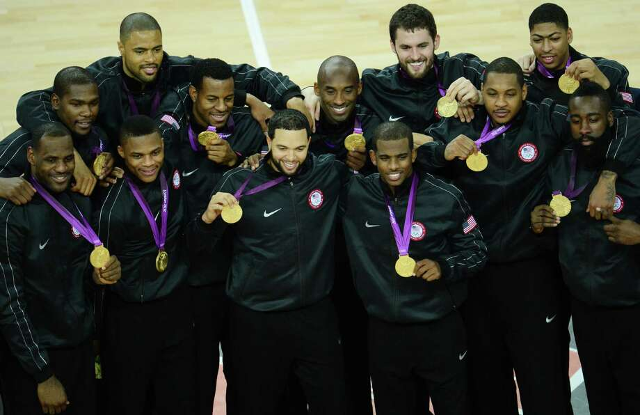 US players pose with their gold medals after winning the London 2012 Olympic Games men's basketball competition at the North Greenwich Arena in London on August 12, 2012. The US won the gold medal followed by the silver to Spain and the bronze to Russia. AFP PHOTO /EMMANUEL DUNANDEMMANUEL DUNAND/AFP/GettyImages Photo: EMMANUEL DUNAND, AFP/Getty Images / AFP