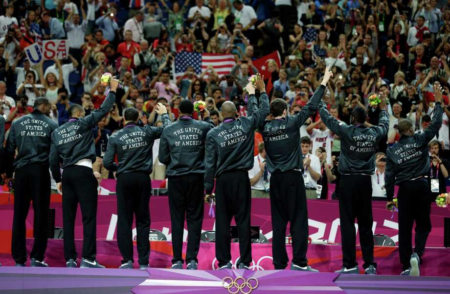 Members of the United States' men's basketball team celebrate after winning the gold medal against Spain at the 2012 Summer Olympics, Sunday, Aug. 12, 2012, in London. (AP Photo/Charles Krupa) Photo: Charles Krupa, Associated Press / AP