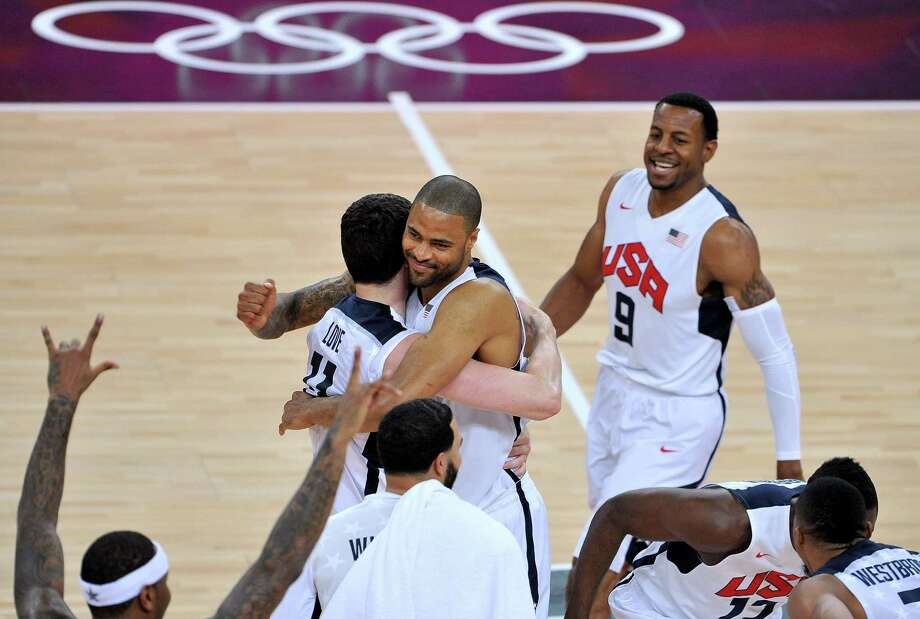 LONDON, ENGLAND - AUGUST 12:  Team mates Chris Paul #13 of the United States and Tyson Chandler #4 of the United States celebrate winning the Men's Basketball gold medal game between the United States and Spain on Day 16 of the London 2012 Olympics Games at North Greenwich Arena on August 12, 2012 in London, England. The United States won the match 107-100. Photo: Pascal Le Segretain, Getty Images / 2012 Getty Images
