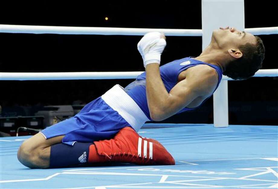 Cuba's Robeisy Ramirez Carrazana reacts after being declared the winner over Mongolia's Tugstsogt Nyambayar in their flyweight 52-kg gold medal boxing match at the 2012 Summer Olympics, Sunday, Aug. 12, 2012, in London. Photo: AP