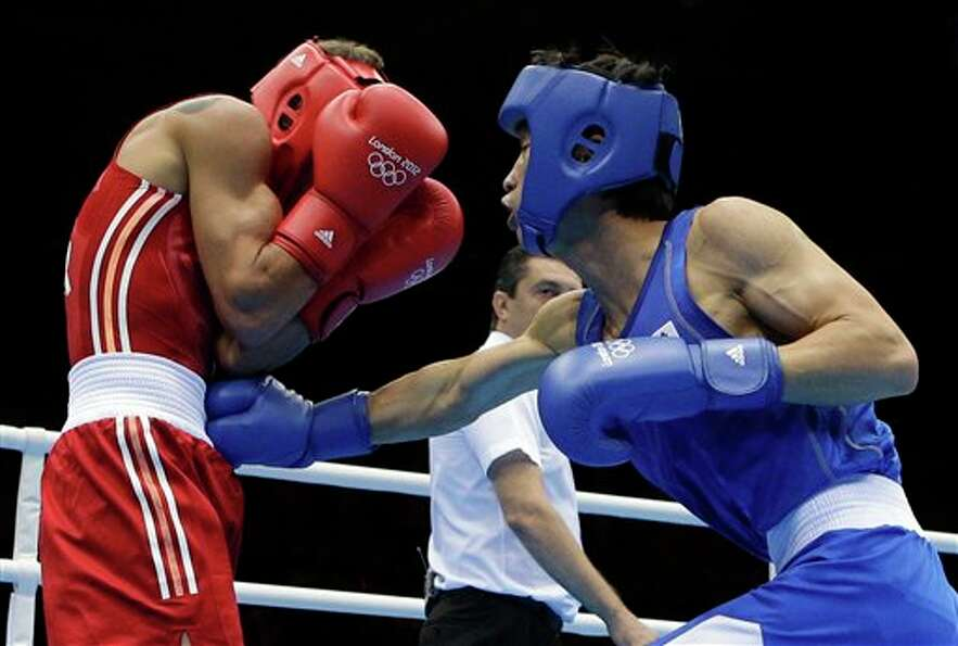 Ukraine's Vasyl Lomachenko, left, fights South Korea's Han Soonchul in a lightweight 60-kg gold meda