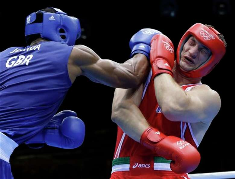 Italy's Roberto Cammarelle, right, fights Britain's Anthony Joshua in a super heavyweight over 91-kg