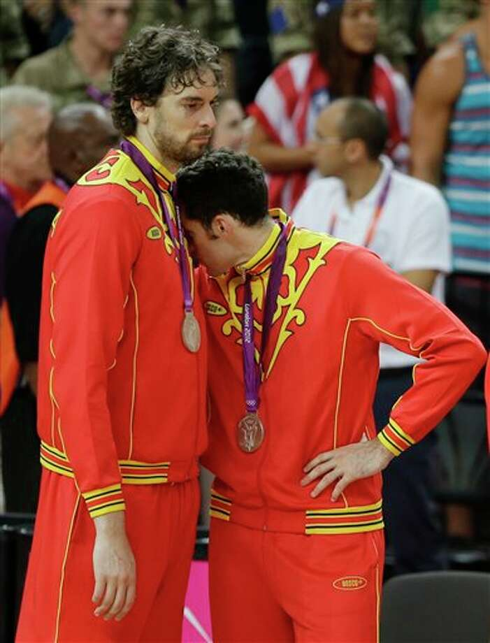 Spain's Pau Gasol, left, and Rudy Fernandez react after getting their silver medal following a ceremony at the 2012 Summer Olympics, Sunday, Aug. 12, 2012, in London. Photo: AP