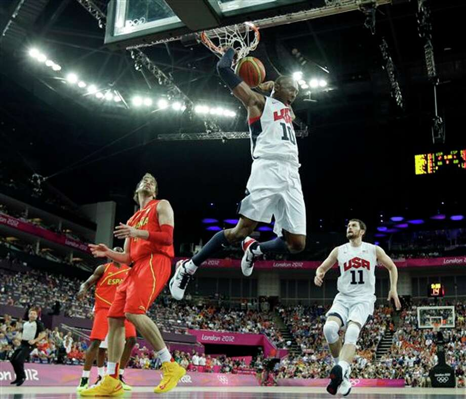 United States' Kobe Bryant reacts after a dunk during a men's gold medal basketball game against Spain at the 2012 Summer Olympics, Sunday, Aug. 12, 2012, in London. Photo: AP