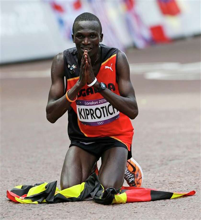 Uganda's Stephen Kiprotich celebrates after crossing the finish line to win gold in the men's marathon at the 2012 Summer Olympics Sunday, Aug. 12, 2012 in London. Photo: AP