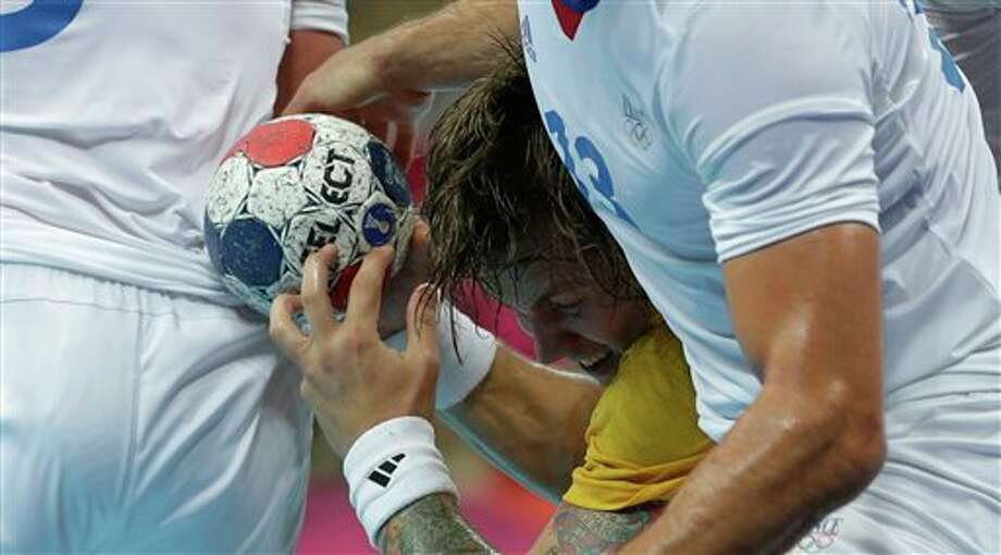 Sweden's Andreas Nilsson challenges for the ball during their men's handball gold medal match at the 2012 Summer Olympics, Sunday, Aug. 12, 2012, in London. Photo: AP