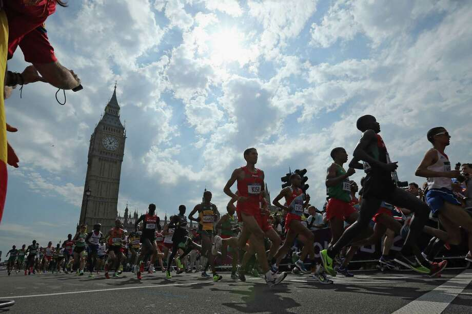 Competitors take part in the men's Marathon. Photo: Dan Kitwood, Getty Images / 2012 Getty Images