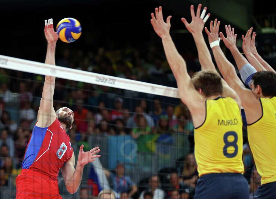 Sergey Tetyukhin #8 of Russia goes up for the shot against Murilo Endres #8 of Brazil during the Men's Volleyball gold medal match. Photo: Elsa, Getty Images / 2012 Getty Images