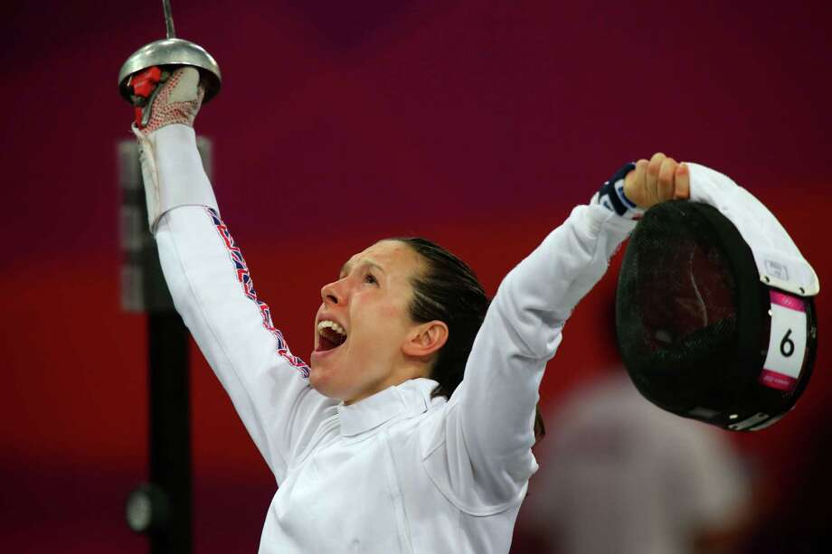 Samantha Murray of Great Britain celebrates during the fencing in the Women's Modern Pentathlon. Photo: Alexander Hassenstein, Getty Images / 2012 Getty Images