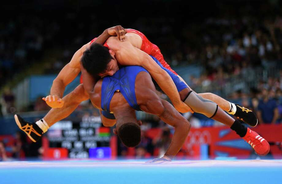 Tatsuhiro Yonemitsu of Japan in action against Livan Lopez Azcuy of Cuba in the Men's Freestyle Wrestling 66kg 1/8 final match. Photo: Ryan Pierse, Getty Images / 2012 Getty Images