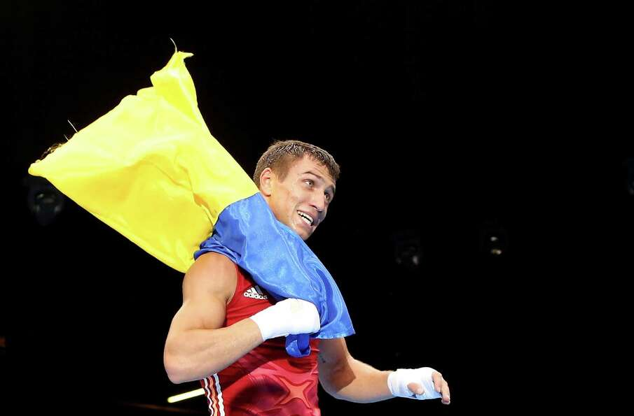 Vasyl Lomachenko of Ukraine celebrates defeating Soonchul Han of Korea during the Men's Light Boxing
