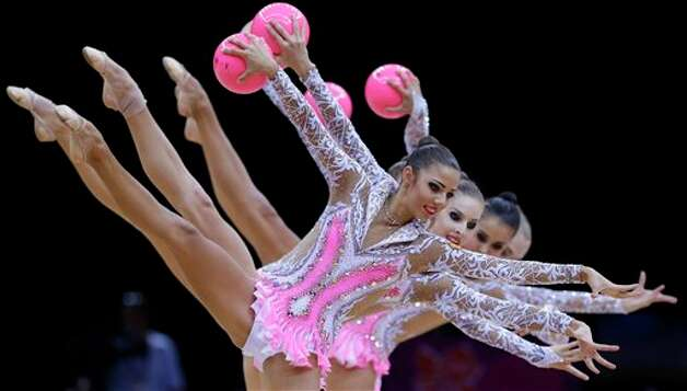 The team from Russia performs during the rhythmic gymnastics group all-around final at the 2012 Summer Olympics, Sunday, Aug. 12, 2012, in London. Photo: AP