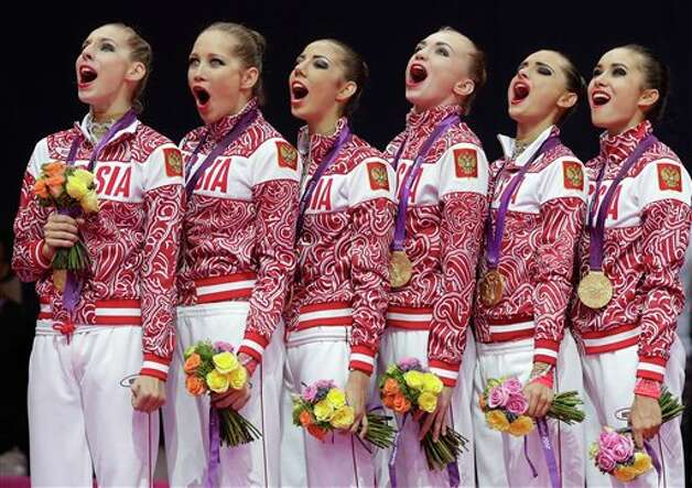 Members of the gold medallist team from Russia sing their national anthem during the podium ceremony of the rhythmic gymnastics group all-around final at the 2012 Summer Olympics, Sunday, Aug. 12, 2012, in London. Photo: AP