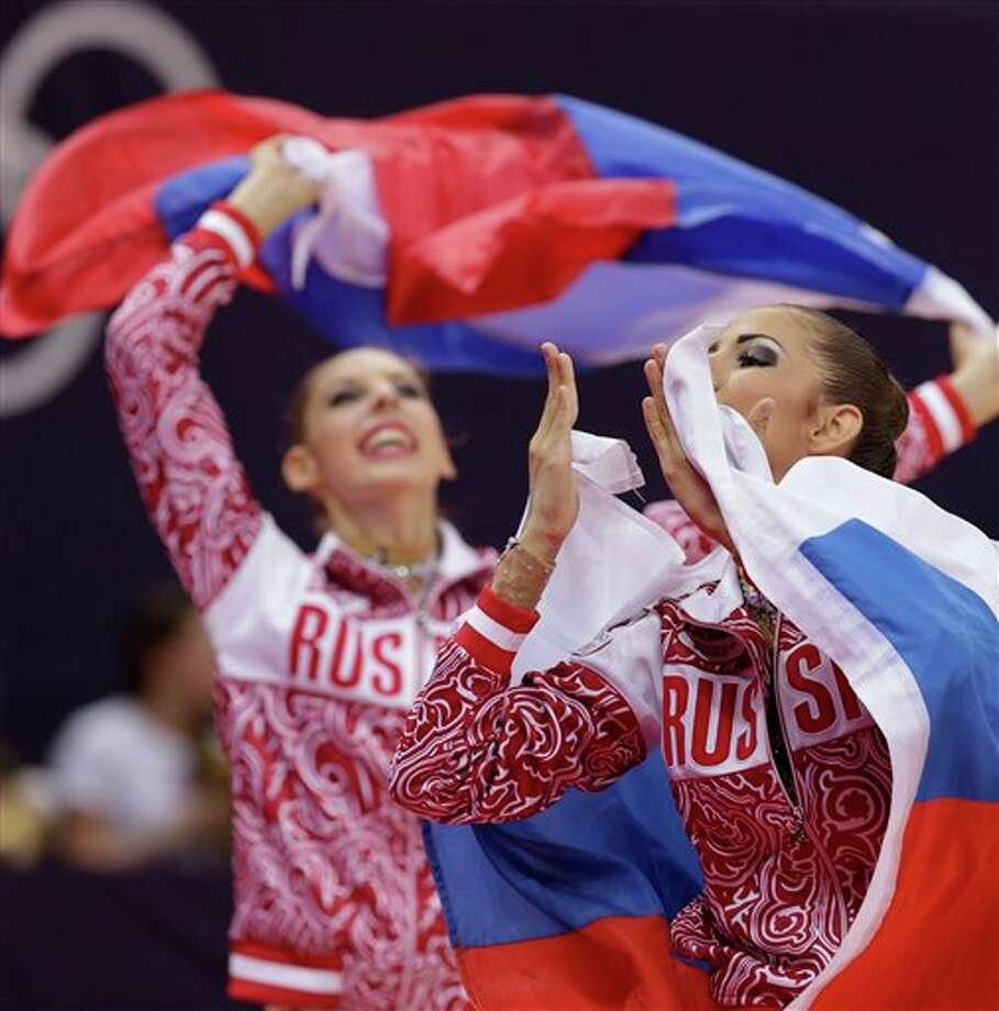 Members of gold medallist team Russia celebrate during the rhythmic gymnastics group all-around final at the 2012 Summer Olympics, Sunday, Aug. 12, 2012, in London. Photo: AP