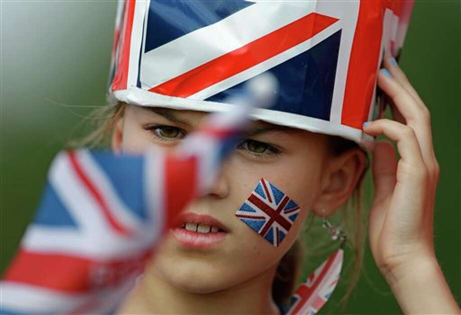 A fan of Great Britain watches the Mountain Bike Cycling men's race, at the 2012 Summer Olympics, Sunday, Aug. 12, 2012, at Hadleigh Farm, in Essex, England. Photo: AP