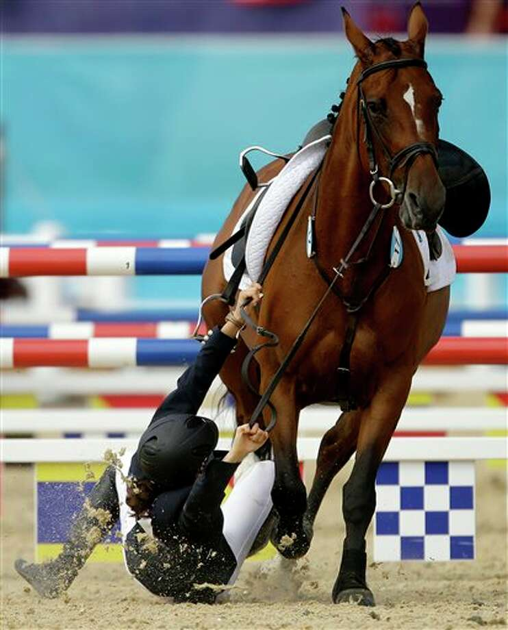 Tamara Vega, of Mexico, falls off her horse Douce de Roulad, during the equestrian show jumping stage of the women's modern pentathlon at the 2012 Summer Olympics, Sunday, Aug. 12, 2012, in London. Photo: AP