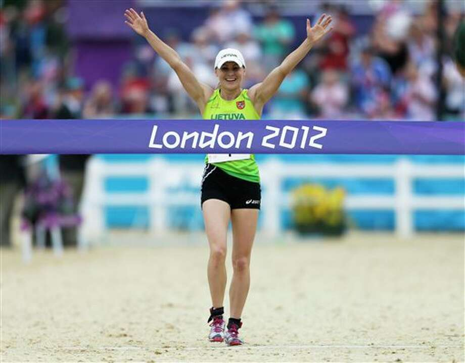 Laura Asadauskaite, of Lithuania crosses the finish line to win in the women's modern pentathlon, at the 2012 Summer Olympics, Sunday, Aug. 12, 2012, in London. Photo: AP