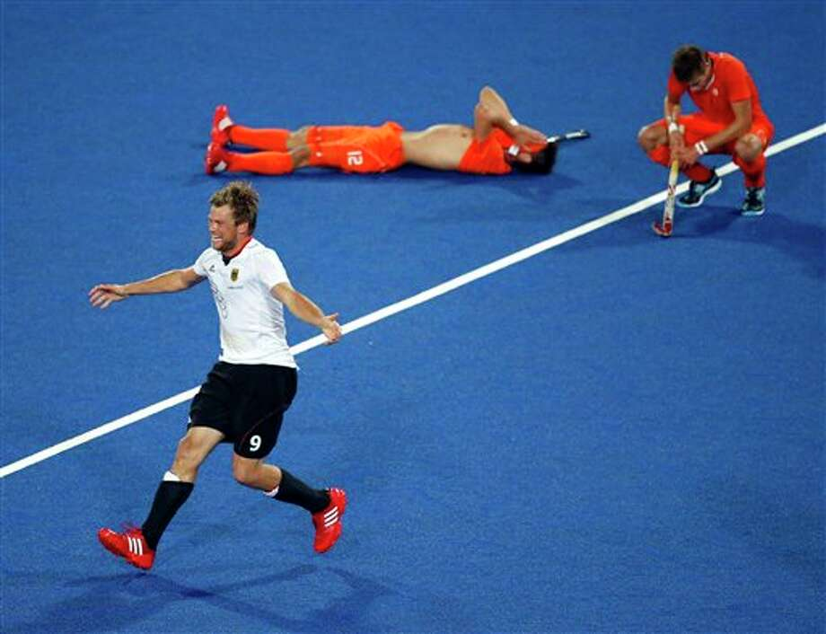 Germany's Moritz Fuerste, left, celebrates his team's 2-1 win against the Netherlands in the men's field hockey gold medal match at the 2012 Summer Olympics, in London, Saturday, Aug. 11, 2012. Photo: AP