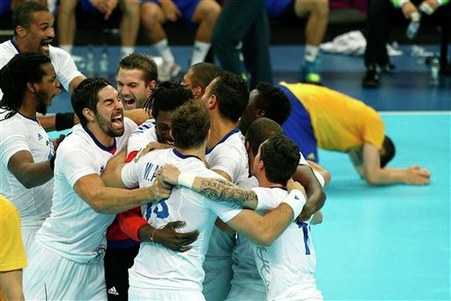 France's players celebrate winning the gold medal match against Sweden at the 2012 Summer Olympics,
