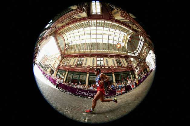 Juan Carlos Cardona of Colombia runs through Leadenhall Market as he competes in the Men's Marathon. Photo: Ezra Shaw, Getty Images / 2012 Getty Images