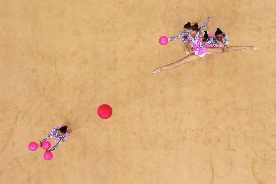 Russia perform with the ball during the Group All-Around Rhythmic Gymnastics final rotation. Photo: Ian Walton, Getty Images / 2012 Getty Images