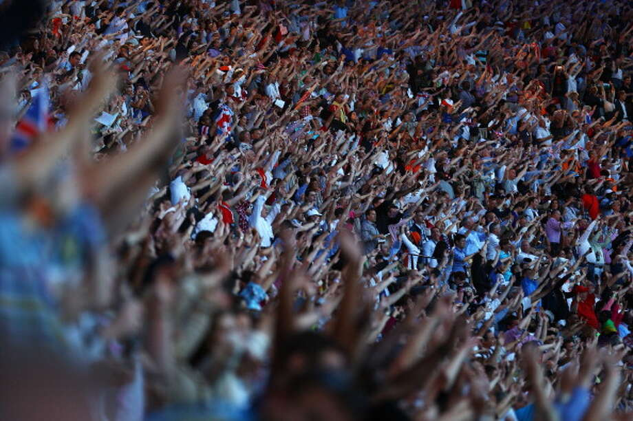 Spectators soak up the atmosphere during the Closing Ceremony in London. Photo: Getty Images