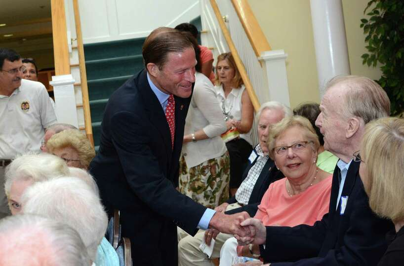 United States Senator Richard Blumenthal greets WWII Army veteran George Lowell, a resident of Atria