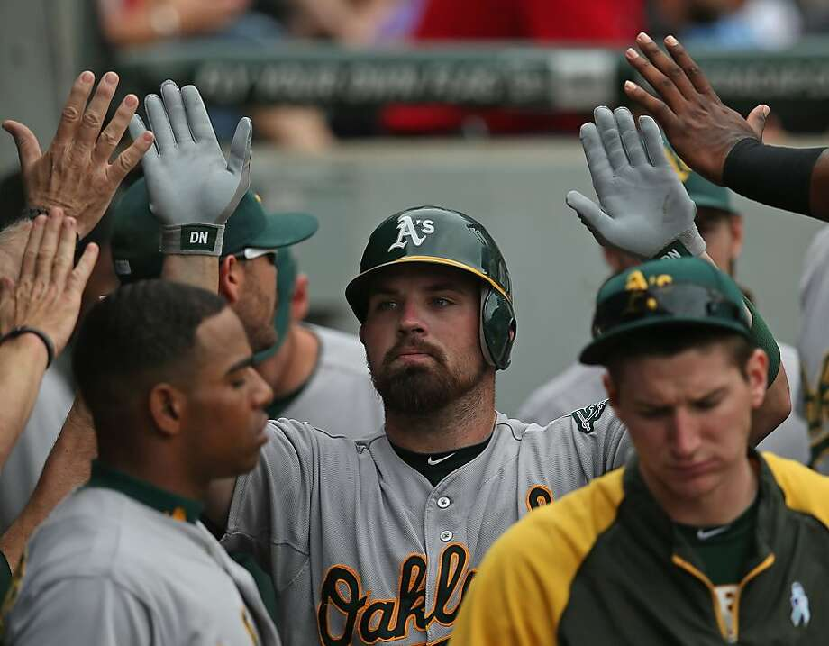 Derek Norris #36 of the Oakland Athletics is congratulated by teammates in the dugout after hitting a solo home run in the 9th inning against the Chicago White Sox at U.S. Cellular Field on August 12, 2012 in Chicago, Illinois. The White Sox defeated the Athletics 7-3.  (Photo by Jonathan Daniel/Getty Images) Photo: Jonathan Daniel, Getty Images