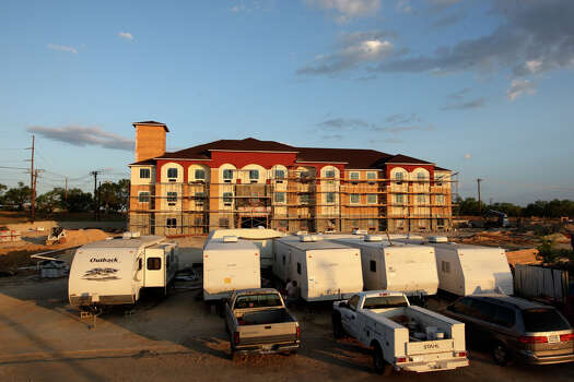 Housing for construction workers is located in front of Best Western under construction in Pleasanton, Texas, Wednesday, August 8, 2012. Demands for housing throughout the Eagle Ford play is up due to the high volume of workers brought to the area by the industry. Photo: Jerry Lara, San Antonio Express-News / © 2012 San Antonio Express-News