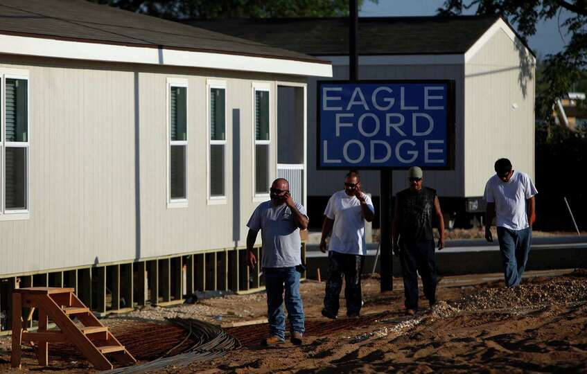 Workers walk around the construction site for the Eagle Ford Lodge being built in Pleasanton on Wedn