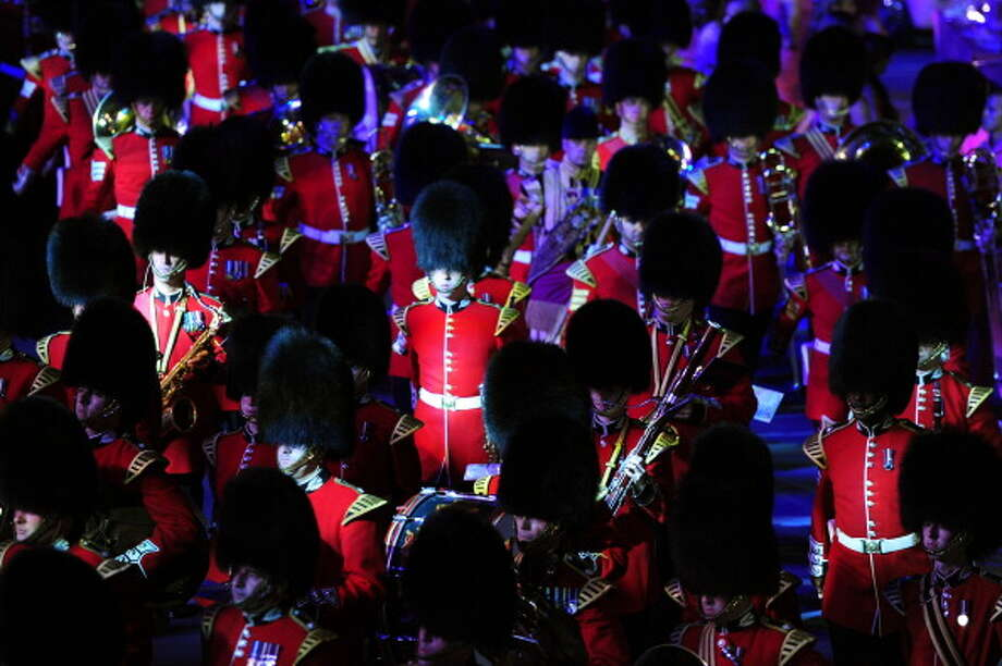 The Household Division Ceremonial State band marches by during the Closing Ceremony. Photo: Getty Images
