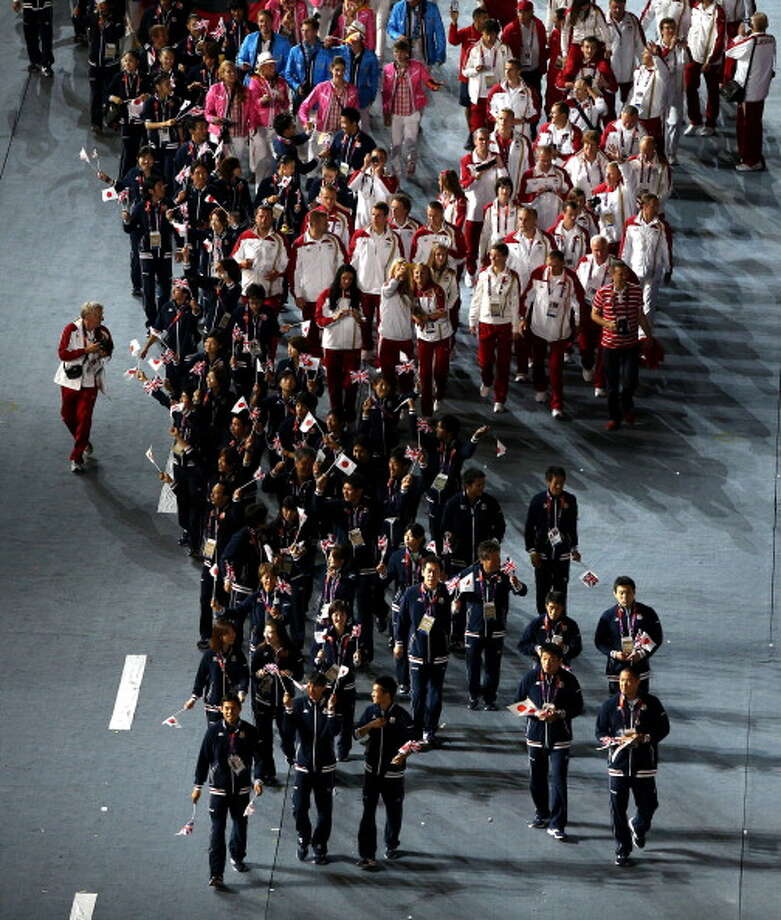 The teams from Japan and Canada parade into the stadium during the Closing Ceremony in London. Photo: Getty Images