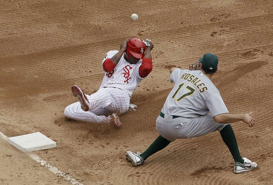 Chicago White Sox's Dewayne Wise, left, is safe at third base as Oakland Athletics third baseman Adam Rosales waits for the ball during the sixth inning of a baseball game in Chicago, Sunday, Aug. 12, 2012. (AP Photo/Nam Y. Huh) Photo: Nam Y. Huh, Associated Press