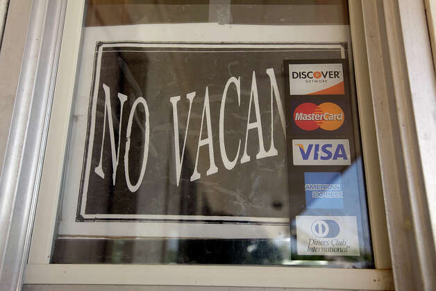 A no vacancy sign is posted at Balia Inn Motel in Carrizo Springs, Texas, Thursday, June 9, 2011. The demand for living space by oilfield workers drawn to the area by the Eagle Ford play has forced the motel not to take reservations and rooms are available on a first come first serve basis. At the start of the day, the hotel had five rooms available but in not time, those rooms were rented. JERRY LARA/glara@express-news.net Photo: JERRY LARA, San Antonio Express-News / SAN ANTONIO EXPRESS-NEWS