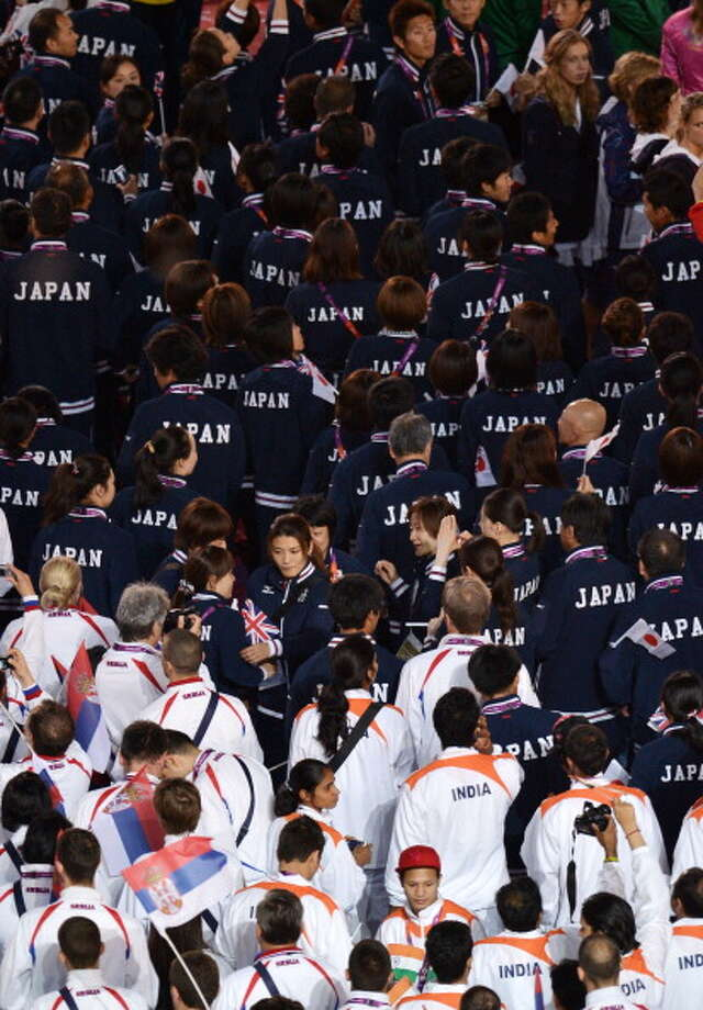 The teams from Serbia, India and Japan parade through the stadium during the Closing Ceremony. Photo: Getty Images
