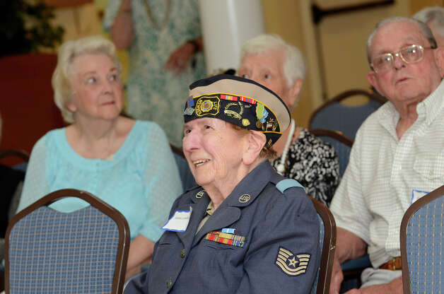WWII veteran Jennie Lombardi, a resident of Atria Senior Living facility in Darien, proudly wears her U.S. Women's Army Corps uniform as she participates in the observation of the 67th anniversary of the end of WWII at Atria on Sunday, Aug. 12, 2012. Photo: Amy Mortensen / Connecticut Post Freelance