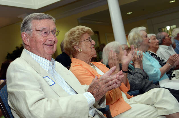 WWII veteran Donald Kibben, of Darien, and his wife, Dorothy, participate in the observation of the 67th anniversary of the end of WWII at Atria on Sunday, Aug. 12, 2012. Photo: Amy Mortensen / Connecticut Post Freelance