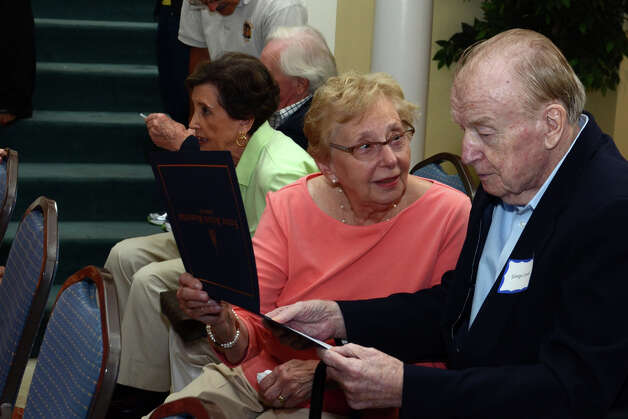 WWII Army veteran George Lowell, a resident at Atria Senior Living in Darien, looks over his certificate with his wife, Jean, of Westport, during the observation of the 67th anniversary of the end of WWII at Atria on Sunday, Aug. 12, 2012. Photo: Amy Mortensen / Connecticut Post Freelance