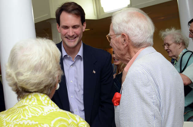 Congressman Jim Himes chats with WWII Army Signal Corps veteran C. Lincoln Jewett and his wife Truda Jewett, of Darien, during the observation of the 67th anniversary of the end of WWII at Atria Senior Living in Darien on Sunday, Aug. 12, 2012. Photo: Amy Mortensen / Connecticut Post Freelance