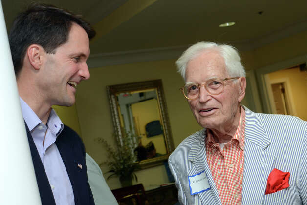 Congressman Jim Himes chats with WWII Army Signal Corps veteran C. Lincoln Jewett, of Darien, during the observation of the 67th anniversary of the end of WWII at Atria Senior Living in Darien on Sunday, Aug. 12, 2012. Photo: Amy Mortensen / Connecticut Post Freelance