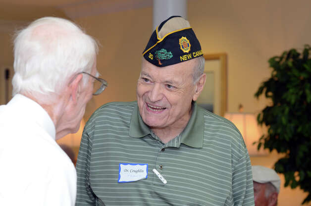 WWII Merchant Marine veteran Dr. Frank Couglin, of New Canaan, speaks with WWII Army veteran John Rikert, of Darien, during the observation of the 67th anniversary of the end of WWII at Atria Senior Living in Darien on Sunday, Aug. 12, 2012. Photo: Amy Mortensen / Connecticut Post Freelance