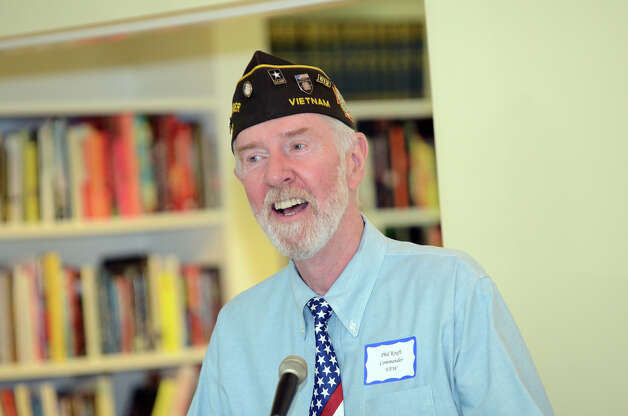 Phillip Kraft, Commander of the Darien VFW Post 6933, leads veterans in the singing of God Bless America during the observation of the 67th anniversary of the end of WWII at Atria Senior Living in Darien on Sunday, Aug. 12, 2012. Photo: Amy Mortensen / Connecticut Post Freelance