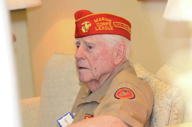 WWII Marine veteran Eugene Coyle, of Darien, during the observation of the 67th anniversary of the end of WWII at Atria Senior Living in Darien on Sunday, Aug. 12, 2012. Photo: Amy Mortensen / Connecticut Post Freelance