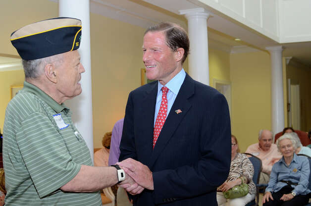 WWII Merchant Marine veteran Dr. Frank Coughlin, of New Canaan, greets United States Senator Richard Blumenthal during the observation of the 67th anniversary of the end of WWII at Atria Senior Living in Darien on Sunday, Aug. 12, 2012. Photo: Amy Mortensen / Connecticut Post Freelance