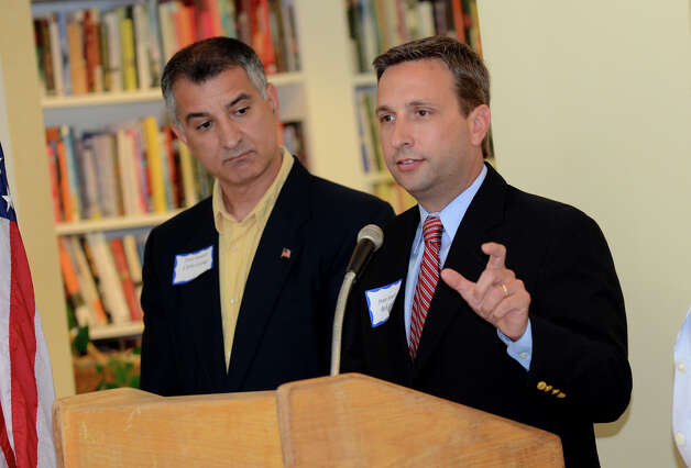 State Senator Bob Duff (D-Norwalk) speaks as State Senator Carlo Leone (D-Stamford) looks on during the observation of the 67th anniversary of the end of WWII at Atria Senior Living in Darien on Sunday, Aug. 12, 2012. Photo: Amy Mortensen / Connecticut Post Freelance