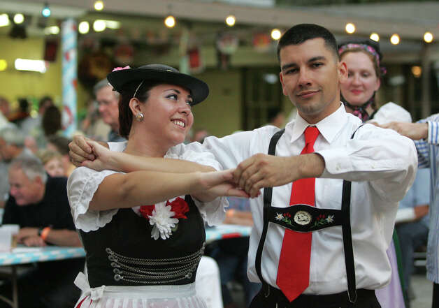 Jessica Dye and boyfriend Daniel Griego dance with the Der Deutsche Volkstanzverien group, a German folk dance group during Oktoberfest, sponsored by the Beethoven Maennerchor in San Antonio, Texas on Friday, October 1, 2010. The event continues Saturday and next weekend with more German music, dancing, food, and of course, beer and wine. Photo: ALICIA WAGNER CALZADA, SPECIAL TO THE EXPRESS-NEWS / Alicia Wagner Calzada