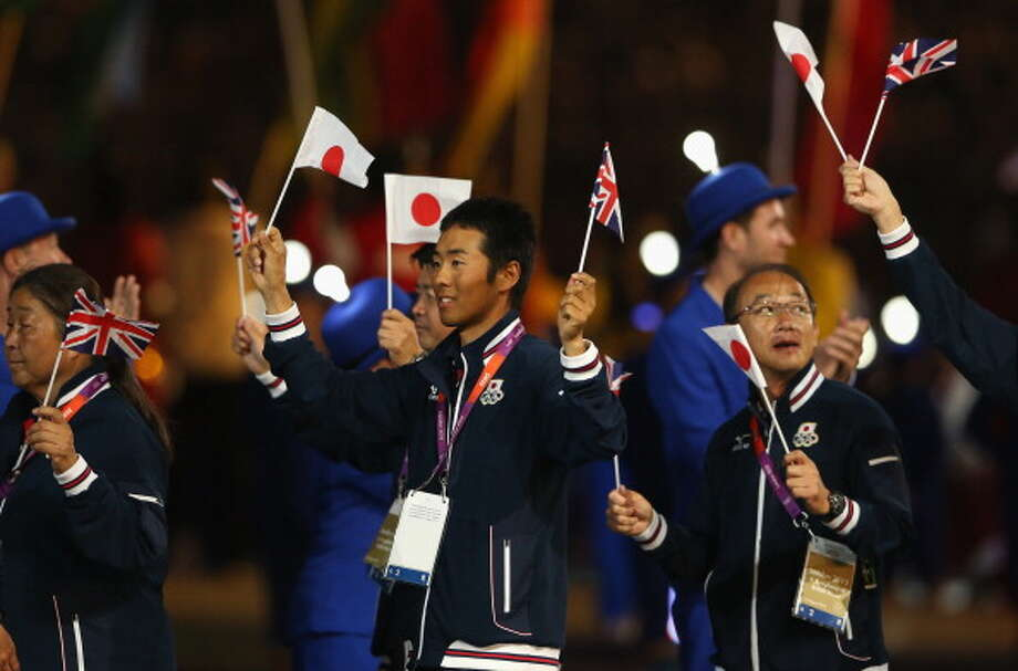 Japanese athletes parade during the Closing Ceremony. Photo: Getty Images