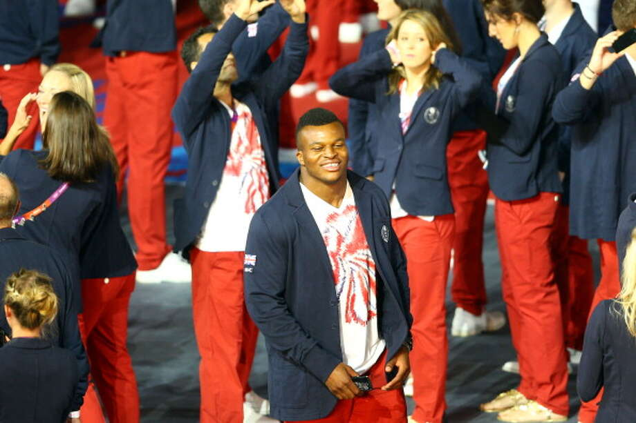 Athlete Lawrence Okoye of Great Britian enjoys the atmosphere during the Closing Ceremony. Photo: Getty Images
