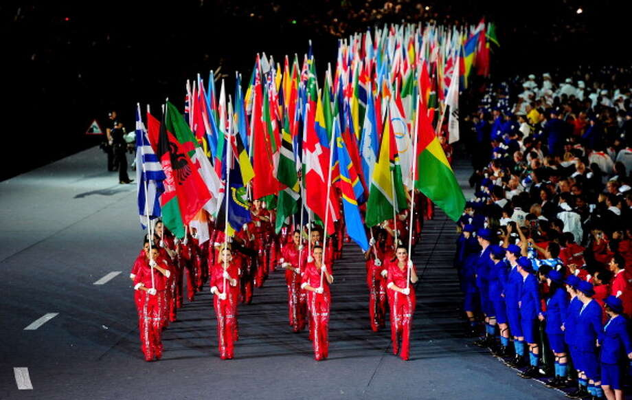 The flags of the competing nations are paraded through the stadium during the Closing Ceremony. Photo: Getty Images